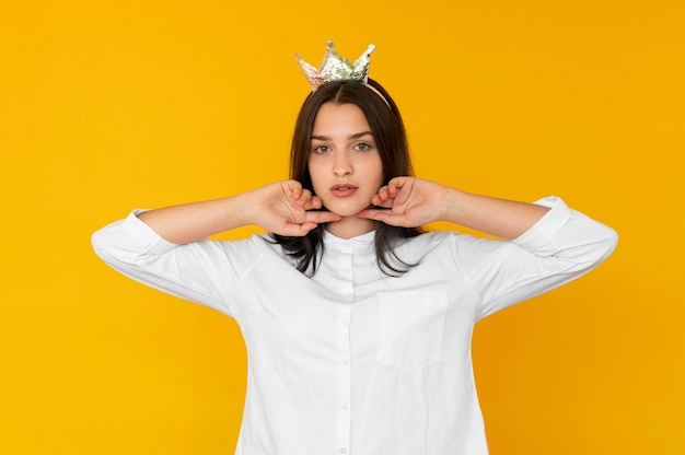Front view of girl wearing a crown concept
