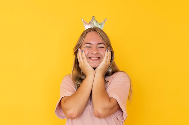Front view of girl wearing a crown with copy space