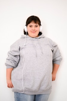 Front view girl with headphones listening to music