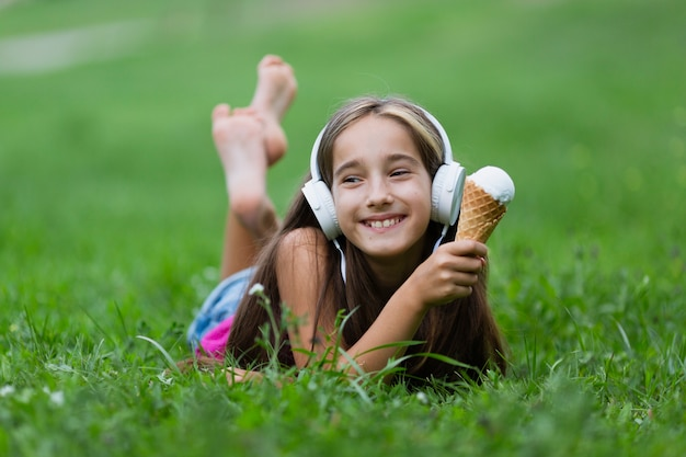 Front view of girl with vanilla ice cream