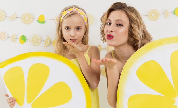 Front view of girl and woman blowing kiss