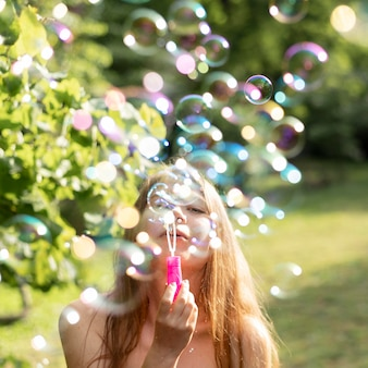 Front view of girls making bubbles