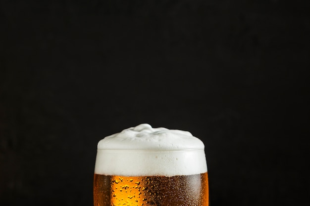 Front view of glass of beer with copy space