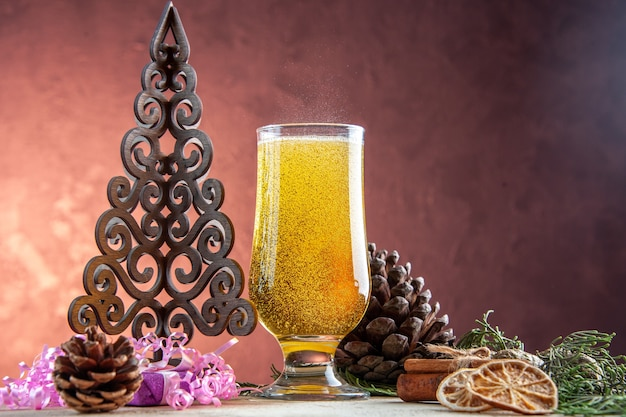 Front view glass of champagne with cones and presents on light color drink alcohol wine party