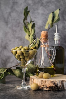 Front view glass filled with olives