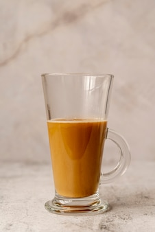 Front view glass of milk coffee