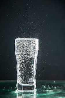 Front view glass of soda full on a dark drink photo champagne xmas water