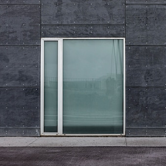 Front view of glass window in a city building