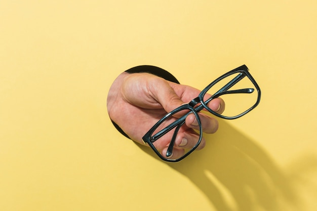 Front view glasses held by person