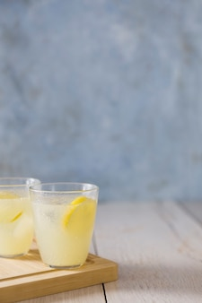 Front view of glasses of lemonade