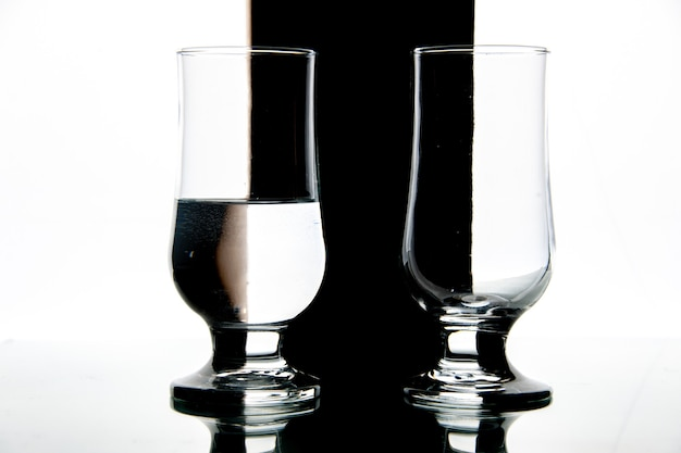 Front view glasses of water on black-white drink wine photo transparent