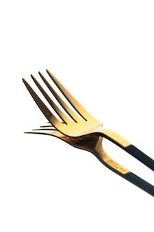 正面図白い背景の上の金色のフォーク