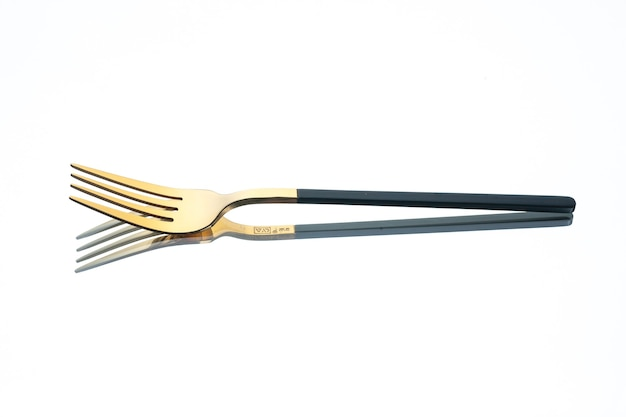 Front view golden fork on white background