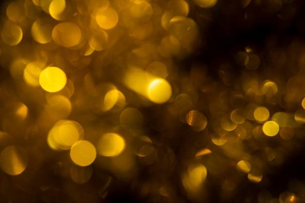 Вид спереди золотые огни в новогоднюю ночь