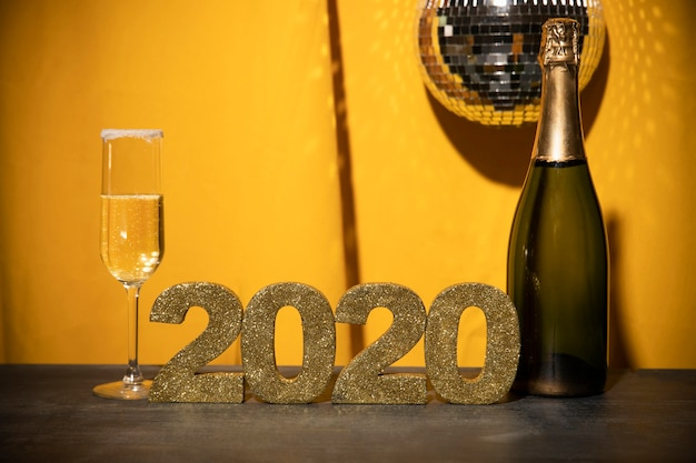 Front view golden sign with new year date on table