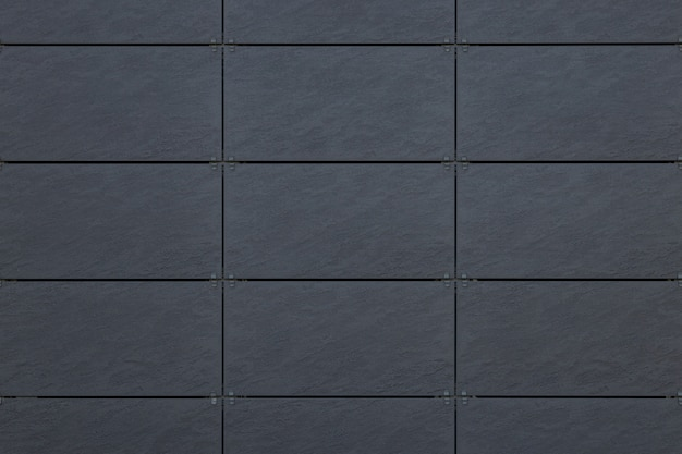 Front view of gray tile on wall with dark grid line for texture