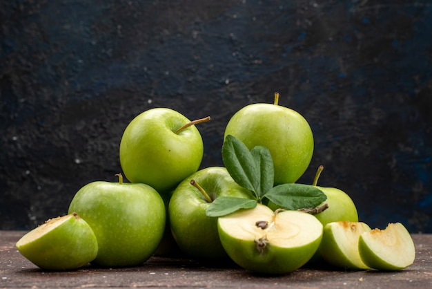 A front view green apple fresh and mellow on the dark background fruit color vitamine healthy