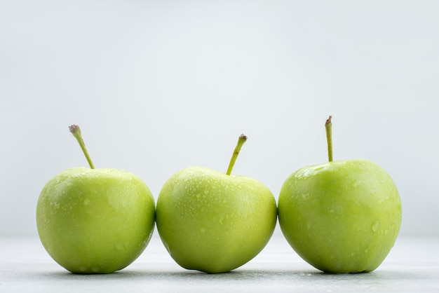 Front view green apples lined on white fruit mellow juice food meal