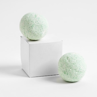Front view green bath bombs on white background
