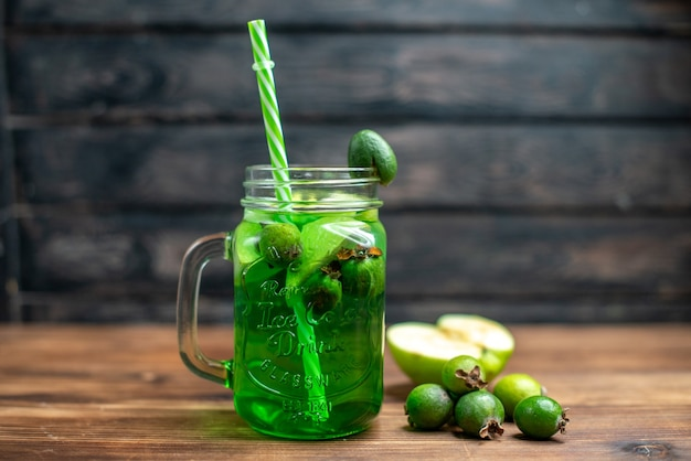 Front view green feijoa juice inside can on dark bar fruit color photo cocktail drink