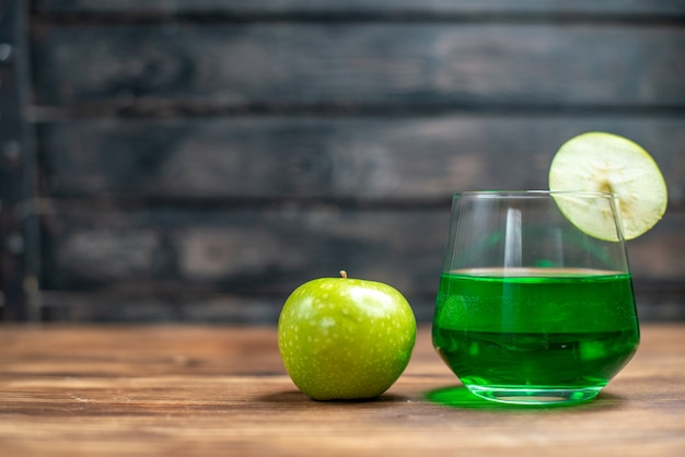 Front view green feijoa juice with green apple on wooden desk bar fruit color drink photo cocktail