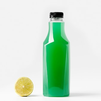 Front view of green juice bottle with lime