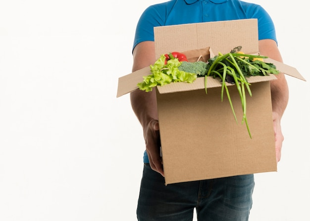 Front view of grocery box held by delivery man