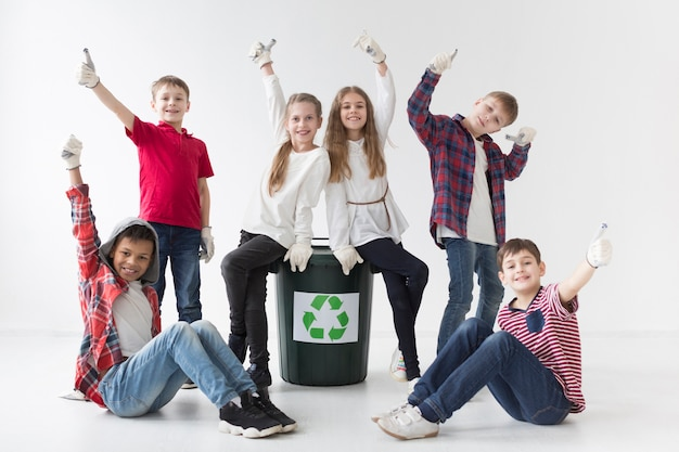 Front view group of kids happy to recycle