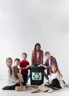 Front view group of kids posing recycle together