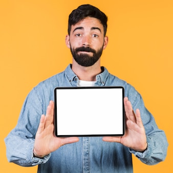 Front view guy holding a tablet