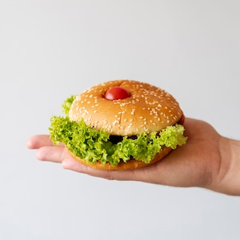 Front view hamburger held by person