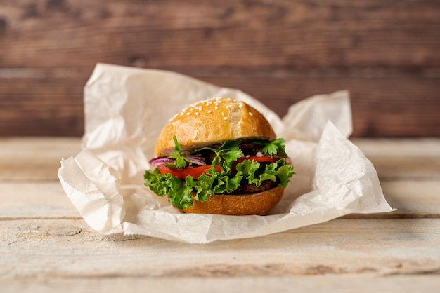 Front view hamburger with wooden background