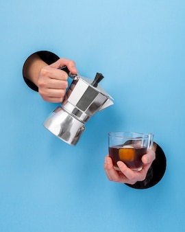 Front view hand holding hot beverage