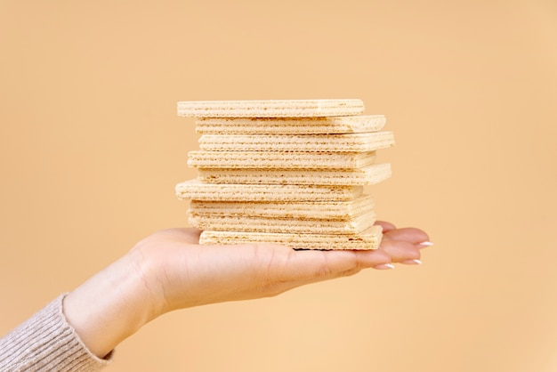 Front view of hand holding stack of wafers
