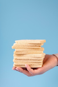 Front view of hand holding stacked wafers with copy space