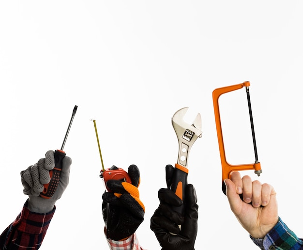 Front view of hands holding tools with copy space