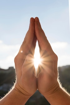 Front view of hands in prayer stance