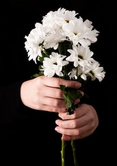 Front view hands with spring flowers