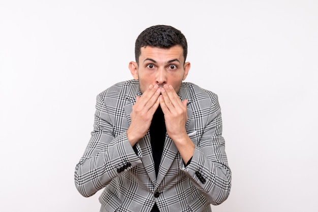 Front view handsome male in suit covering his mouth with hands standing on white background