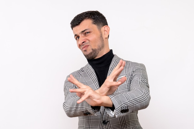 Front view handsome male in suit crossing hands standing on white background