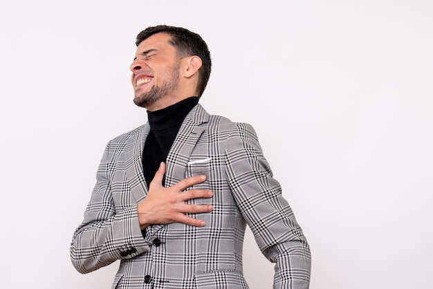 Front view handsome male in suit holding his chest with pain standing on white background