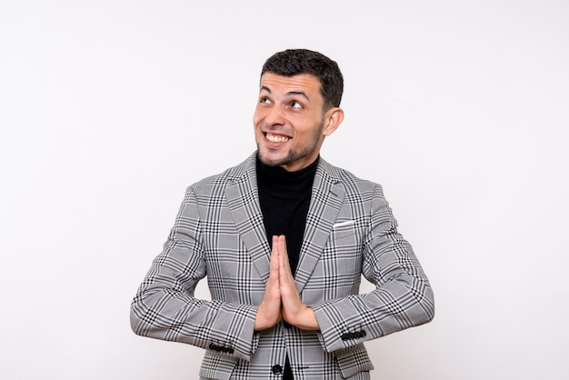 Front view handsome male in suit joining hands together standing on white background
