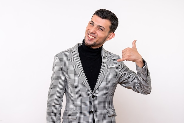 Front view handsome male in suit making call me phone gesture standing on white background