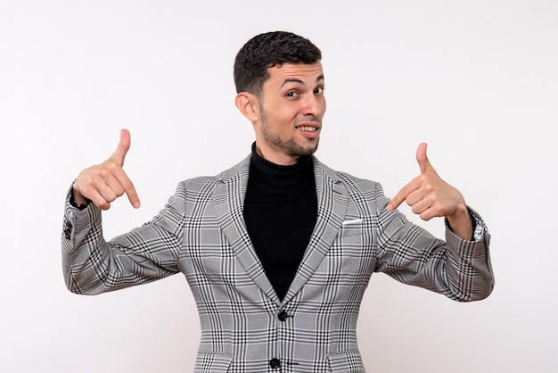 Front view handsome male in suit pointing at himself standing on white background