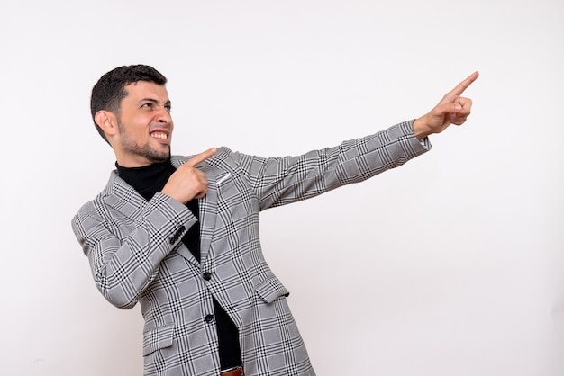 Front view handsome male in suit pointing at something standing on white background
