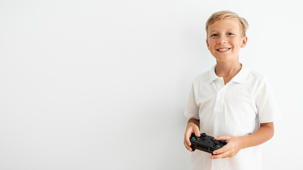 Front view happy child holding a controller