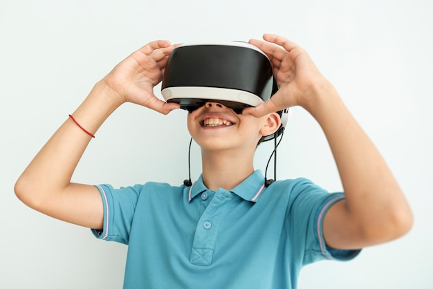 Front view happy child with vr glasses