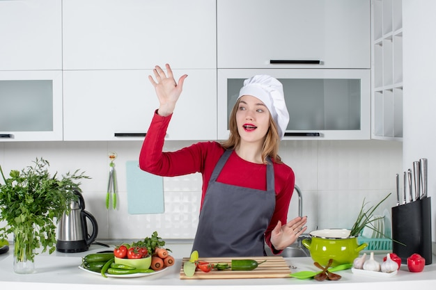 Front view happy female chef in cook hat