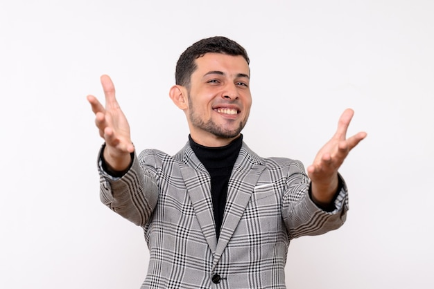 Front view happy handsome male in suit opening hands standing on white background
