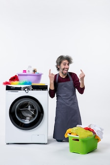 Front view happy housekeeper man standing on knee pointing with fingers up on white isolated background